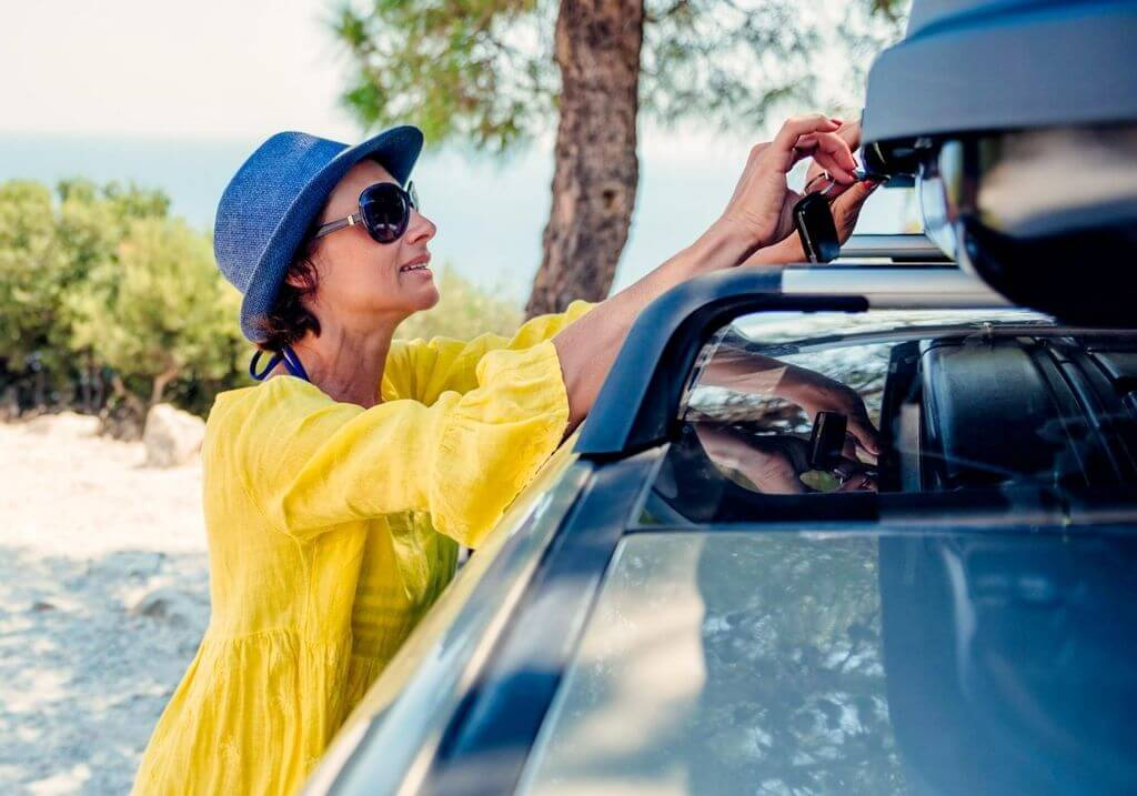 Woman roofrack car roadtrip planning RF